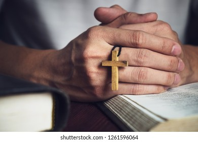 Man Praying to God with a Bible in the Morning Devotion.