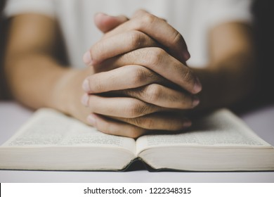 Man is praying with the hands holding together.