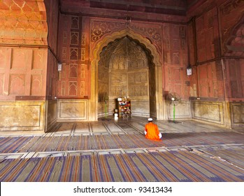 man praying in the Jama Masjid Mosque in Delhi