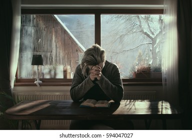 Man Praying and Meditating About Bible