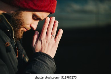 Man praying outside to God