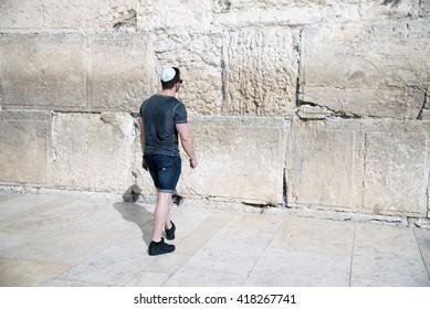 Man praying at the Wailing Walll Jerusalem,Israel