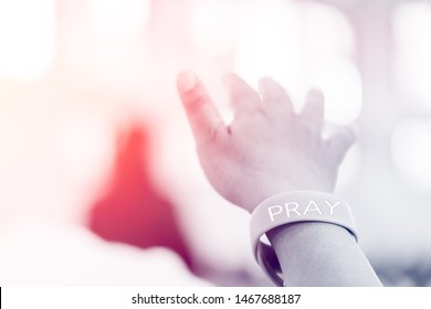 Man praying and worship to GOD in Church.Man raised hands and pray to GOD.Hand praying and bless to all Nation.Concept Praise and worship with faith, spirituality and Surrender.black and white tone.
