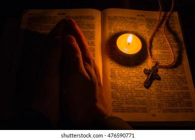 man prays selective focus