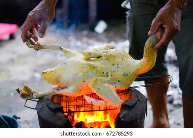 The man Preparation of Roast Duck on fireplace.  Duck is a food delicious from Thailand,Roast Duck Rustic folk food