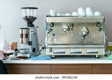 A man prepare coffee bean with Professional coffee machine