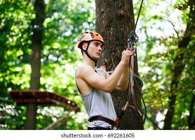 Man prepares to climb on the ropes in the park