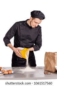 Man preparing bread dough on  table in a bakery. food cooking, baking and people concept