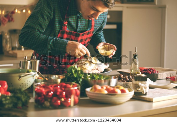 Man preparing delicious and healthy food in the home kitchen for christmas (Christmas Duck or Goose)