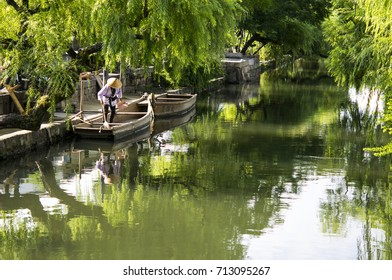 A man is preparing his boat on a river. This is a view of a daily morning in Kurashiki Okayama Japan.