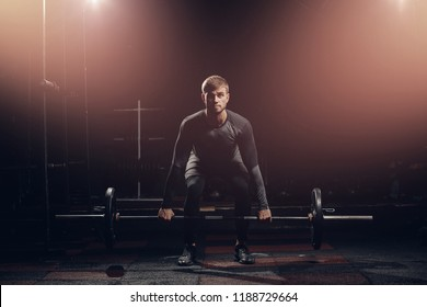 Man is preparing to press bar, weightlifting. Sport workout background.