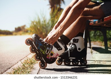 Man preparing for roller with his rollerskates