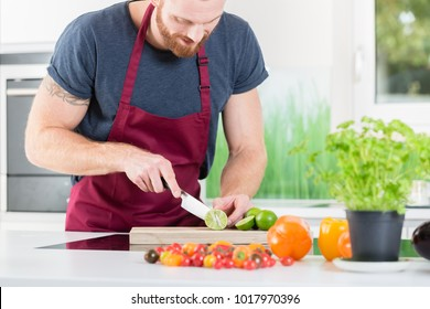 Man preparing veggies for cooking in kitchen