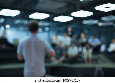 Man Presenting to Audience. Presentation. Blurred De-focused