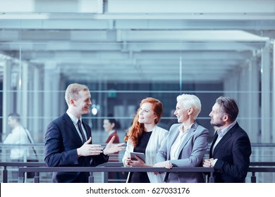 Man presenting business offer to group of clients