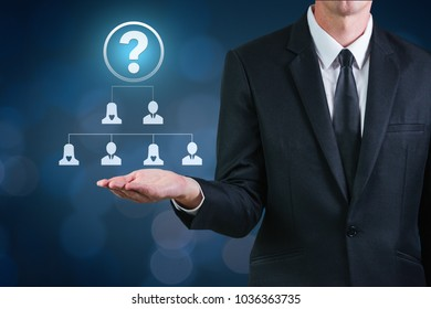 Man presenting new organizational chart in the team company with new director as question mark