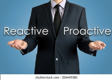 man presents with their hands for a decision problem between reactive or proactive on blue background