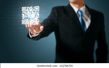 Man press on QR code