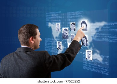 Man pressing Social network pictures in digital futuristic blue background