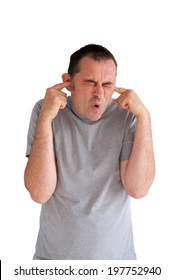 man preventing hearing damage by blocking ears from a loud noise