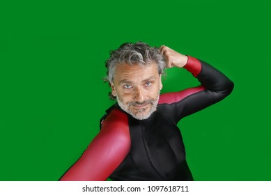 man in professional triathlon suit, isolated over green screen