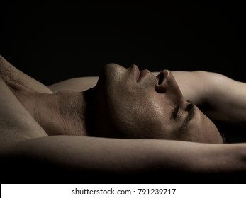 man profile with arms up and closed eyes