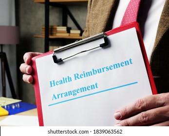 Man proposes Health Reimbursement Arrangement HRA documents. - Shutterstock ID 1839063562