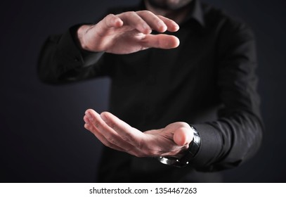 Man with protecting hands. Protecting gesture
