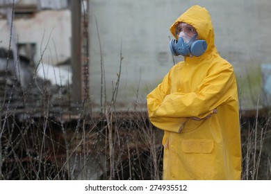 Man with protective  mask and protective  clothes  explores danger area.
