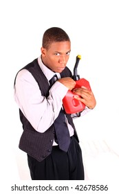 A man is protectively holding a gas can from the viewer