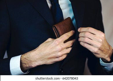 Man pulled out of his inside jacket pocket wallet