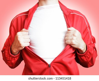 man pulling open shirt showing white t shirt