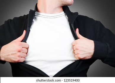 man pulling open shirt showing white t shirt