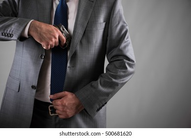 Man pulling out gun from his pocket