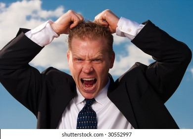 a man pulls his hair out in frustration