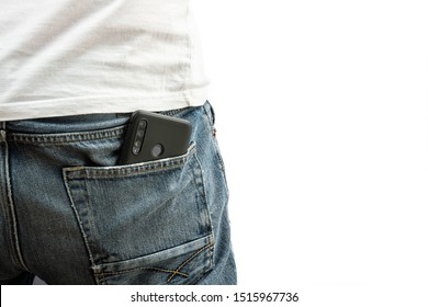 A man pulls a smartphone out of the back pocket of his jeans
