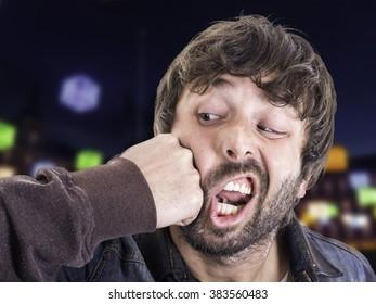 man punching himself