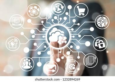 Man push a cloud jigsaw button on a virtual screen in the form of a microcircuit. Smart cloud. Digital web storage. Neural computing database.