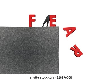 man push red fear word down on top of concrete building isolated on white background, overcoming fear concept.
