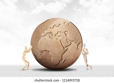 Man pushes the Earth and another person sabotages it. Abstract image with a wooden puppet