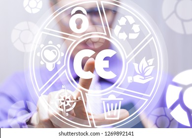 Man pushing a ce abbreviation icon on a virtual screen. CE - european conformity certification mark business industry system.