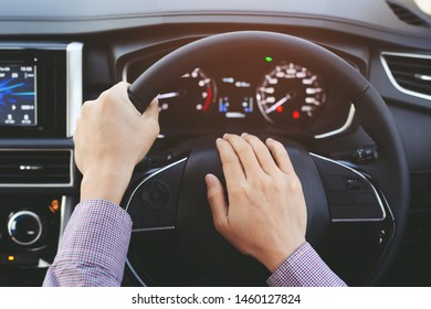 man pushing horn while driving sitting of a steering wheel press car, honking sound to warn other people in traffic concept.