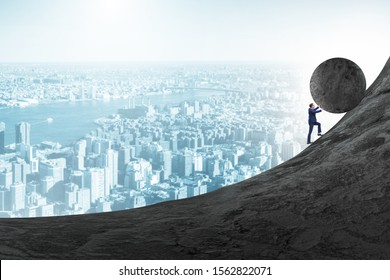 Man pushing large stone to the top
