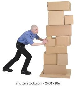 Man pushing pile cardboard boxes on white