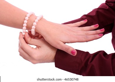 Man put a bracelet on the woman's hand