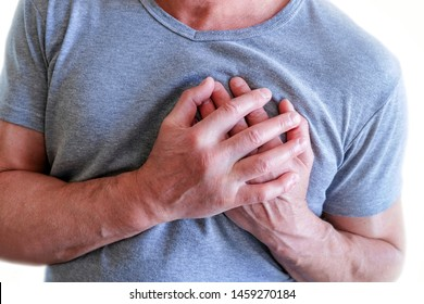 The man put his hands around the chest, pain in . Chest spasm, angina pectoris. Heart attack.