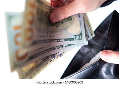 A man puts dollars in his wallet. Savings. Rational spending of money. Obtaining additional income. Investment. Reasonable consumption. The creation of the monetary airbags.