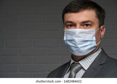 a man puts a mask on his face for antivirus individual protection - healthcare and medicine concept, prevention tips