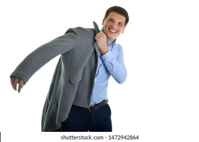 Man puts on a coat outside in cold weather