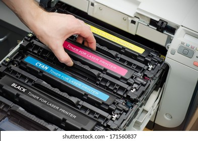 Man puts toner in the printer